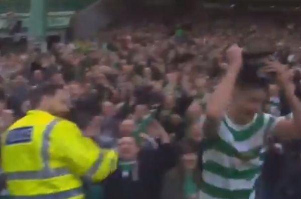 Celtic's Mikael Lustig steals police hat celebrating James Forrest goal v Rangers