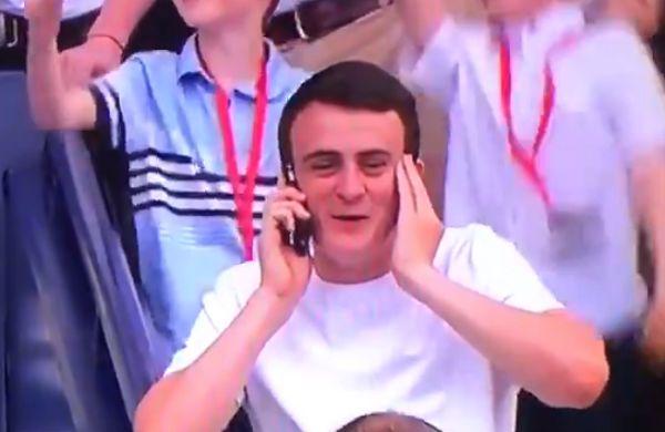 Celtic fan on phone during trophy presentation