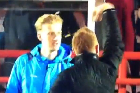 Aldershot manager Gary Waddock waves down fans to celebrate
