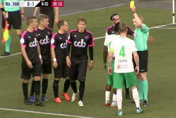 Referee gives penalty and books fouled player during HamKam 1-1 Nest-Sotra