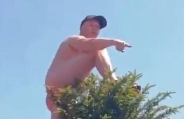 Naked Man Utd fan climbs tree
