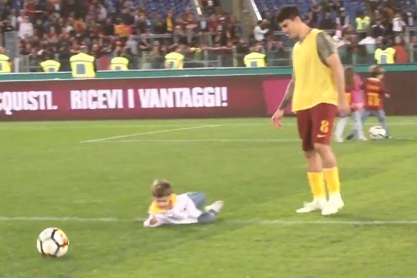 Roma's Diego Perotti trips a mascot