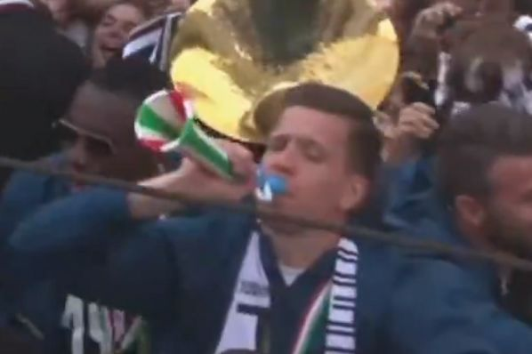 Wojciech Szczęsny sounds the party horn he caught during Juventus's title celebrations