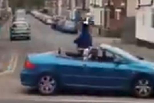 Amateur team Nags Head & Plough FC parade trophy in an open-top car