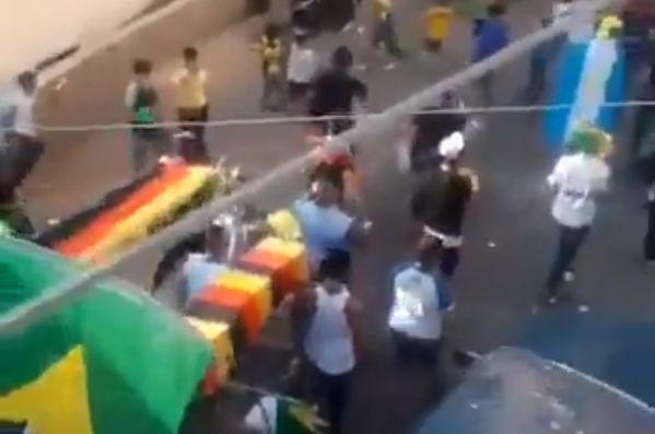Brazil fans hold a funeral march for Germany's World Cup