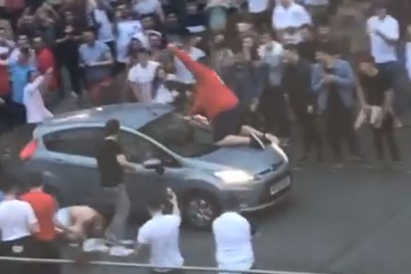 The England fan was thrown off the car bonnet while celebrating the World Cup win over Tunisia and Harry Kane's winner in Plymouth