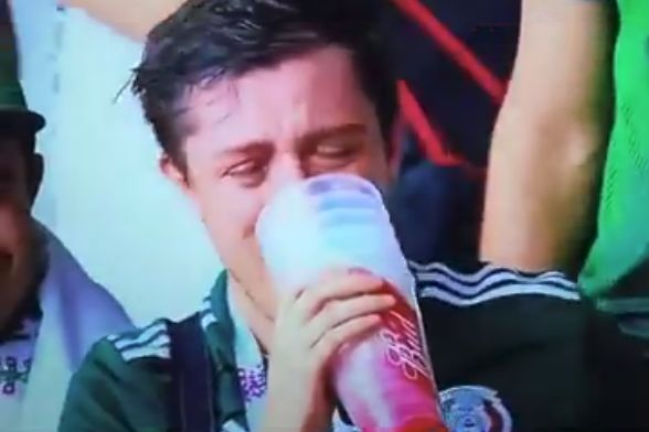 A crying Mexico fan drinks from 6 cups of beer at their World Cup Russia 2018 Round of 16 defeat to Brazil