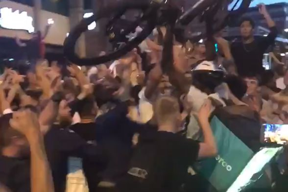 Deliveroo rider joins celebrations of England's penalty-shootout win over Colombia with his bicycle