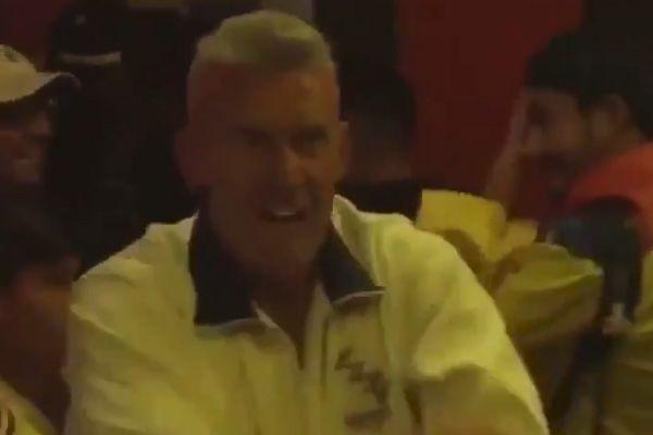 England fan celebrates winning penalty shootout in bar full of Colombians