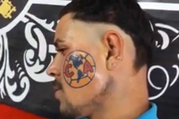 A fan gets the Club América crest tattooed on his cheek in Mexico