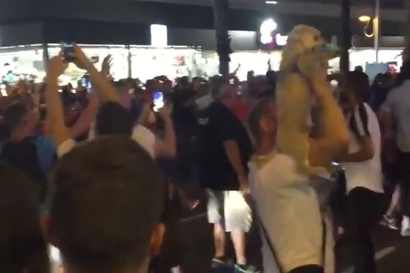 France fan dances with dog celebrating 1-0 World Cup semi-final win over Belgium