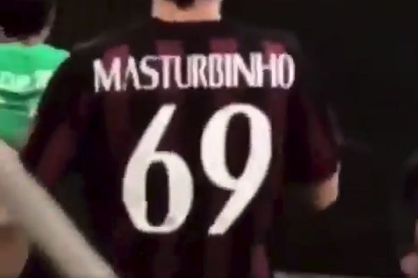 Player at indoor five-a-side match wears Masturbinho 69 shirt