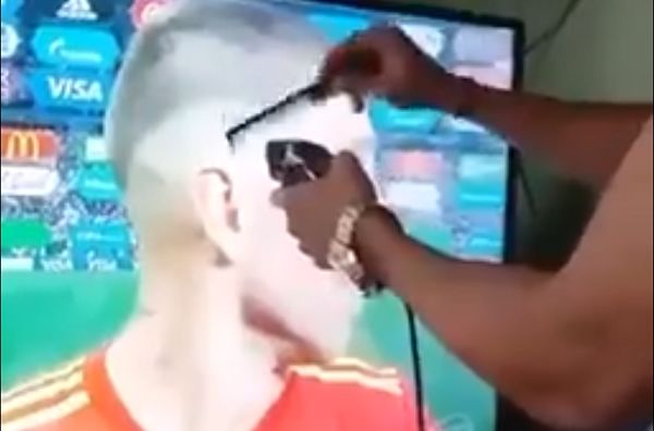 Viewer pretends to cut Sergio Ramos's hair after Russia beat Spain on penalties at World Cup