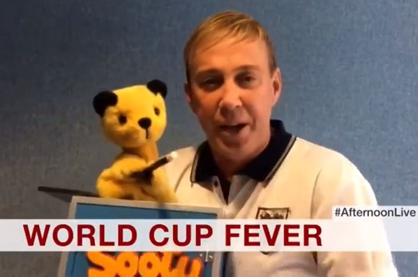 Sooty offers his support to England on BBC News before the World Cup semi-final defeat to Croatia at Russia 2018
