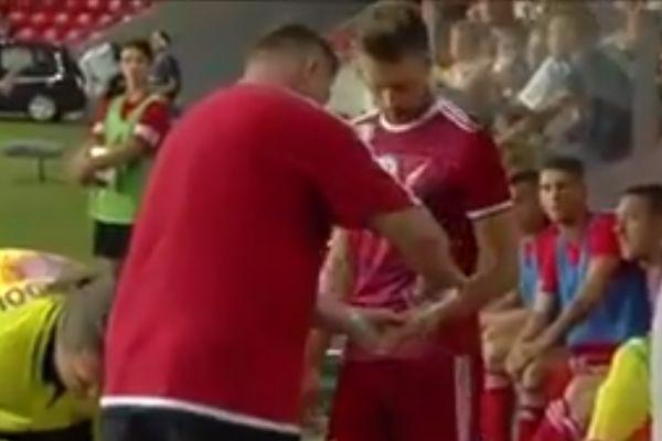 Debrecen staff attempt to remove Erik Čikoš's wedding ring as it delays kick-off against MTK Budapest