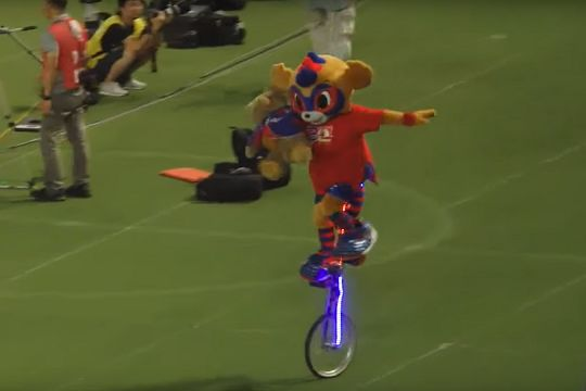 FC Tokyo mascot rides illuminated unicycle at their clash against Vissel Kobe