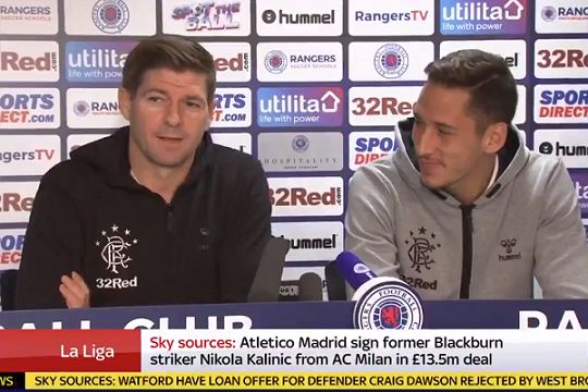 Rangers manager Steven Gerrard translates Scottish reporters' questions into English for Nikola Katić
