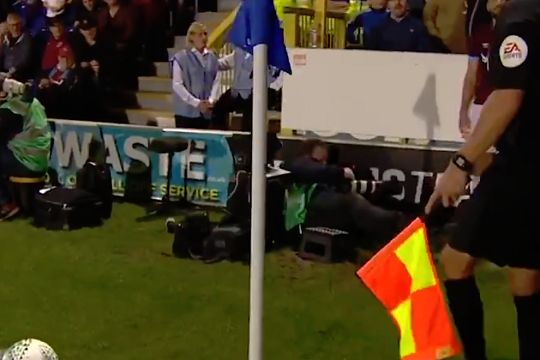 Photographer falls off stool as West Ham's Robert Snodgrass prepares to take a corner in the Carabao Cup at AFC Wimbledon