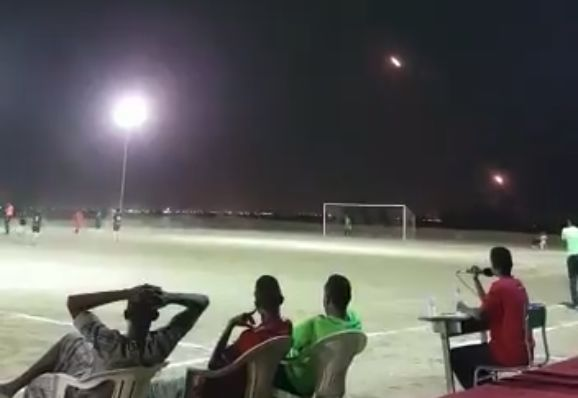 A match played under rocket fire in the Middle East, possibly on the border of Yemen and Saudi Arabia