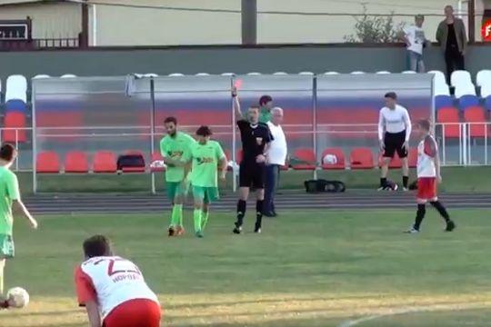 Titan Klin's Arshen Tsagolov is sent off for scoring an own goal in their 7-1 defeat at Metallist Korolev