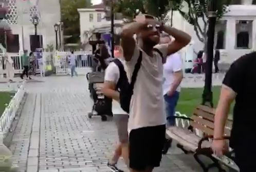 Barcelona's Rafinha kicks a group of children's ball into a tree when trying to pass it back to them