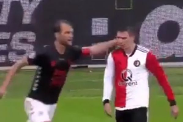 Feyenoord's Steven Berghuis dives after Utretcht's Willem Janssen pats him on the head