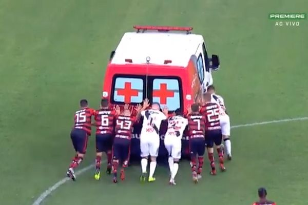 An ambulance carrying Vasco da Gama's Bruno Silva is push started by players