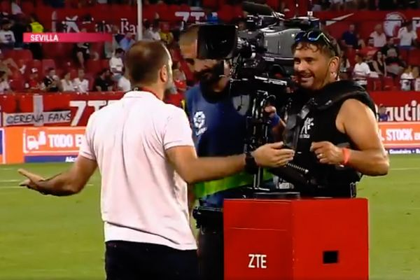 A cameraman knocks the hovering match ball off it's perch at Sevilla before their Europa League clash with Standard Liège