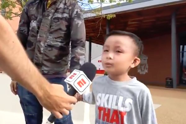 A child from Hong Kong who travelled to Anfield to watch their Champions League win over PSG sings You'll Never Walk Alone and more for ESPN