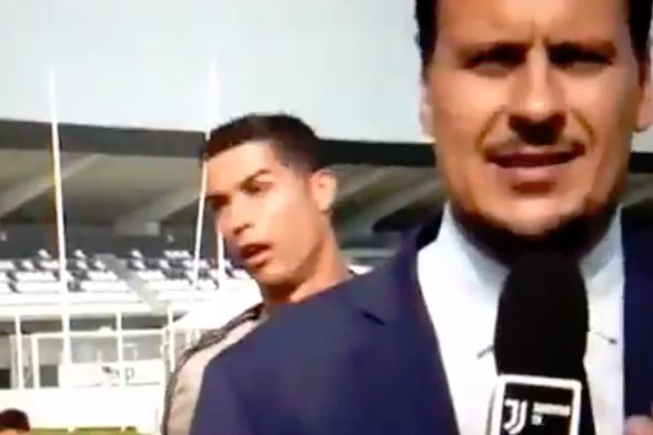 Cristiano Ronaldo imitates a Juventus reporter while standing behind him at the training ground