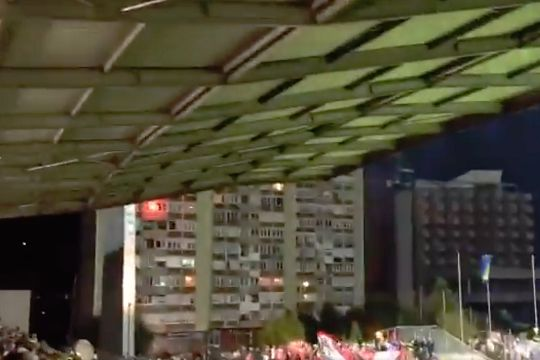 Fan lights flare at window of flat overlooking Bosnia and Herzegovina's 1-0 win over Austria in the Nations League