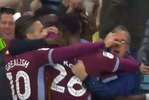 Aston Villa's Jack Grealish tries to swipe a supporter's glasses off his head while celebrating Tammy Abraham's goal