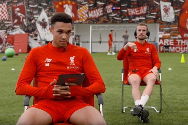 Jordan Henderson tells a LFC TV crew member that his wife is having a baby after a message on his phone during filming