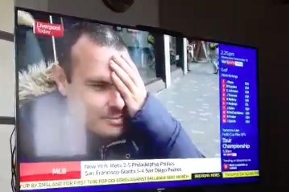 Liverpool fan hold his hand over his eye while speaking to Sky Sports News