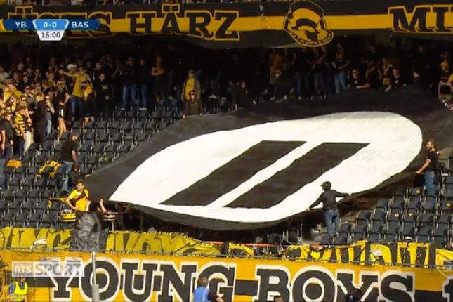 Young Boys fans throw PlayStation controllers and tennis balls on the pitch in a protest against esports during a match against Basel