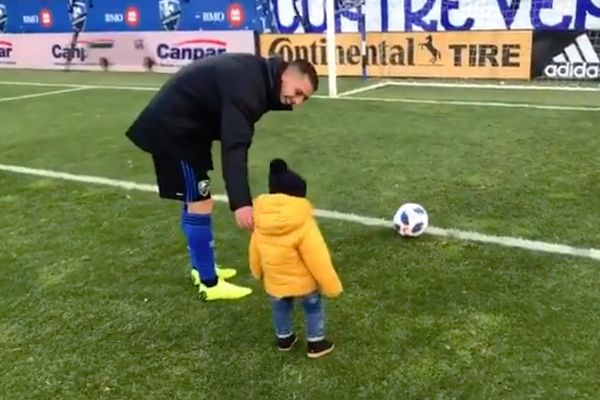 Montreal Impact fans cheer as Alejandro Silva's son dribbles the ball and scores a goal