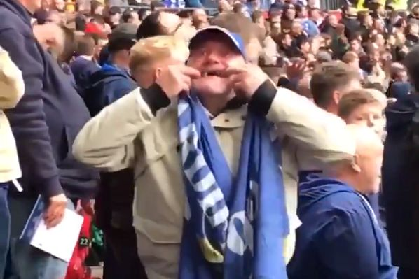 Cardiff supporter pulls a funny face at Spurs fans during a Premier League match at Wembley