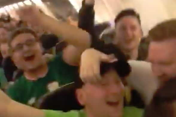 Celtic fans cheer their plane landing in Germany ahead of a Europa League clash at RB Leipzig