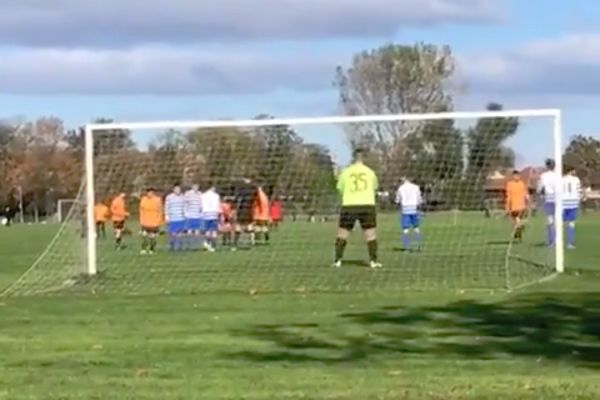 A father videoing his son playing in goal was prevented by a van