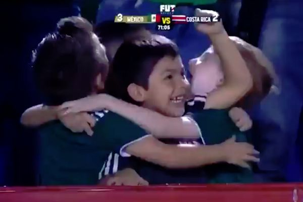 Young Mexico fans group hug after winning goal in 3-2 win against Costa Rica