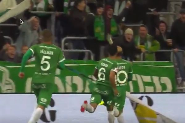 Kennedy Bakircioglü catches beer thrown from crowd after scoring for Hammarby