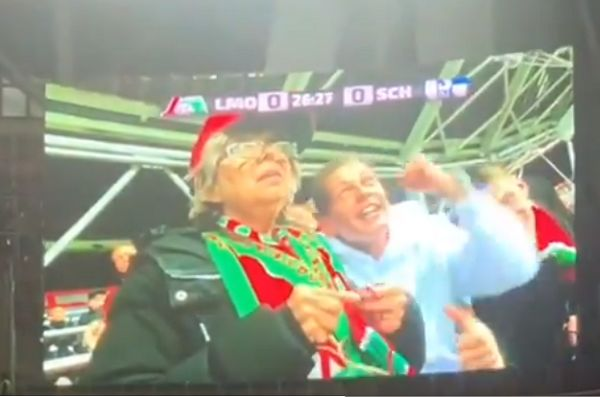Old lady knits in stands at Lokomotiv Moscow v Schalke 04
