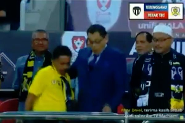 A Perak TBG coach drops his phone while taking selfie at the Malaysia Cup final