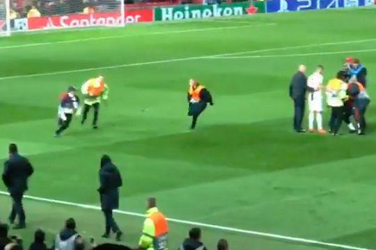 A pitch invader runs away from stewards at Old Trafford after Man Utd vs Juventus