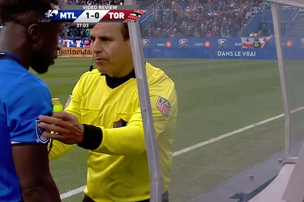 Montreal Impact's Bacary Sagna is booked for watching the video review in an MLS match against Toronto