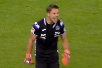 Arminia Bielefeld goalkeeper Stefan Ortega rips open his shirt in frustration at referee's decision