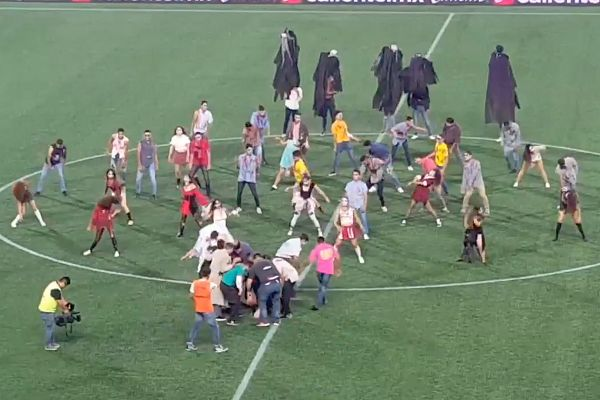 Club Tijuana cheerleaders and academy players dance to Thriller at half-time in a 0-1 defeat to Pumas