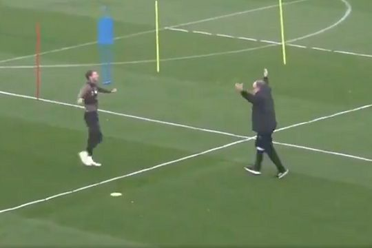 Leeds manager Marcelo Bielsa runs over to Patrick Bamford and celebrates his goal in training