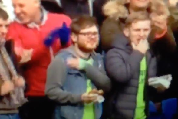 Cardiff City fan celebrates a goal by putting his hand on his heart but picks the wrong side during 2-1 win against Brighton