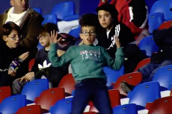 A child dancing in the stands at Levante